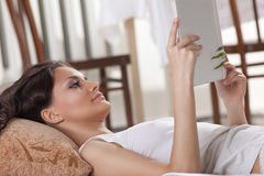 Young woman lay in bed and read book Royalty Free Stock Photo