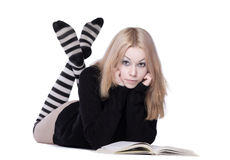 Young woman lay with book Royalty Free Stock Photography