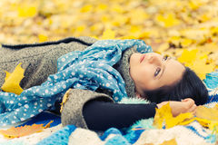 Young woman. Laying in autumn leaves royalty free stock photography