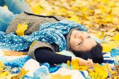 Young woman. Laying in autumn leaves stock photos