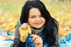 Young woman. Laying in autumn leaves royalty free stock image