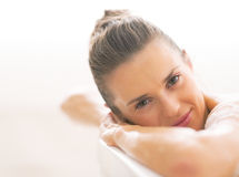 Young woman laying in bathtub Stock Photography