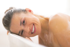 Young woman laying in bathtub Royalty Free Stock Photography