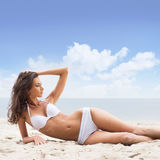 A young woman laying on a beach background Royalty Free Stock Image