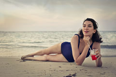 Young woman laying on the beach Royalty Free Stock Photos