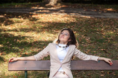 Young woman laying on bench Stock Photo