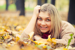 Young woman laying down Royalty Free Stock Photos