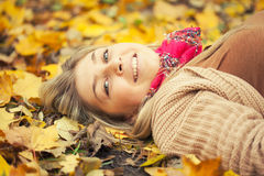 Young woman laying down on the ground Royalty Free Stock Photo