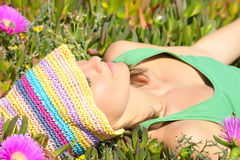 Young woman laying on field Royalty Free Stock Image