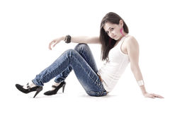Young woman laying on the floor, isolated Royalty Free Stock Photography