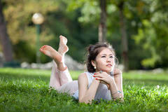 Young woman laying on grass Royalty Free Stock Images