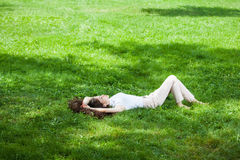 Young woman laying on grass Royalty Free Stock Image