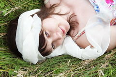 Young Woman Laying on Grass Portrait Stock Photo