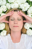 Young Woman Laying In Flowers Stock Photos