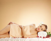 A young woman laying on massage procedure Stock Images