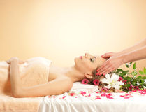A young woman laying on massage procedure Royalty Free Stock Photo