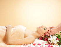 A young woman laying on massage procedure Stock Photo