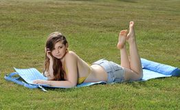 Young woman laying out - summer Stock Images