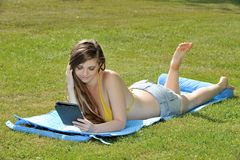 Young woman laying out - summer Royalty Free Stock Photos