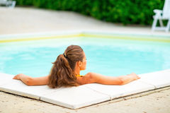 Young woman laying in pool Royalty Free Stock Photos