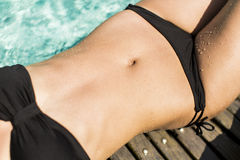 Young woman laying by the pool Royalty Free Stock Images