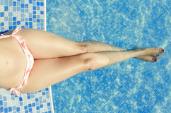 Young woman laying by the pool. Toned photo Royalty Free Stock Image