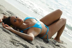 Young Woman Laying On The Sand Stock Photos