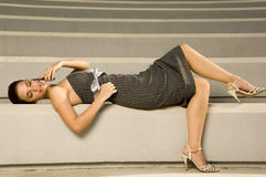 A young woman laying on some steps Royalty Free Stock Photography