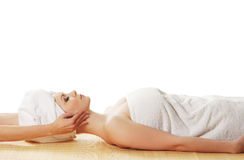 A young woman laying on a spa procedure Royalty Free Stock Photo