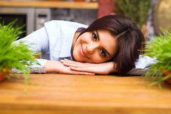 Young woman laying on the table with flowers on it Stock Photos