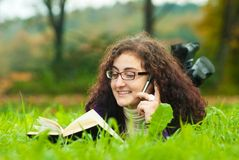 Young woman lays on a grass royalty free stock photography