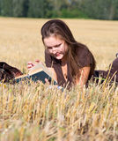 Young woman lays on yellow field Royalty Free Stock Image