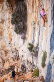Young woman lead climbing on natural cliff Stock Photo