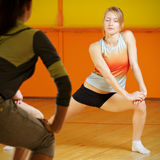Young woman leading aerobics group Royalty Free Stock Photo