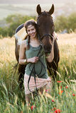 Young woman leading her horse Stock Photos