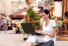 Young woman leads a fun correspondence on a laptop Stock Images