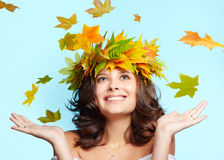 Young woman and leaf fall Royalty Free Stock Photos