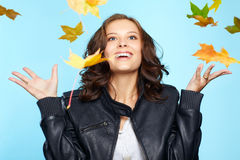 Young woman and leaf fall Royalty Free Stock Images