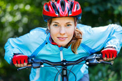 Young woman leaned over handlebar Royalty Free Stock Photo