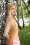 Young Woman Leaning Against Birch In Forest Royalty Free Stock Photo