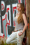 Young woman leaning against wall Royalty Free Stock Photos