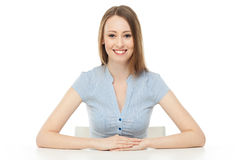 Young woman leaning arms on table Stock Image