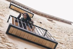 Young woman leaning on the balcony stock images