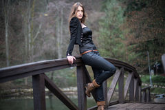 Young woman leaning at the bridge Stock Images