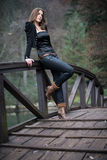 Young woman leaning at the bridge Stock Photography