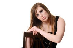 Young woman leaning on chair Stock Photos