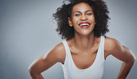 Young woman leaning inward and laughing Stock Photo