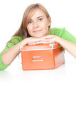 Young woman leaning on the orange box Royalty Free Stock Photo