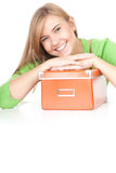 Young woman leaning on the orange box Royalty Free Stock Photos