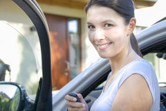 Young woman leans against her car Stock Photo